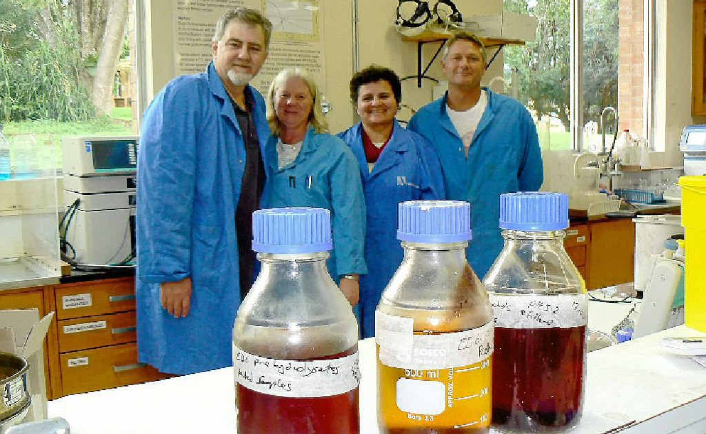 ENERGY FROM WOODY WASTE: NSW DPI Wollongbar's biofuels team stand behind a range of sugar solutions derived from eucalyptus, sorghum and manure. From left: Team leader Dr Tony Vancov, lab technician Janice Palmer, visiting Brazilian professor Rosanna Schneider and senior post-doc Dr Shane McIntosh. Inset are Dr McIntosh and Ms Palmer inspecting the Parr Reactor, which is used to break down woody biomass into a pulp ready for enzyme digestion.
