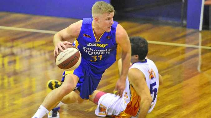 ON THE CHARGE: Power's Shaun Gleeson moves up-court against the Townsville Flames at Kev Broome Stadium, Gladstone.
