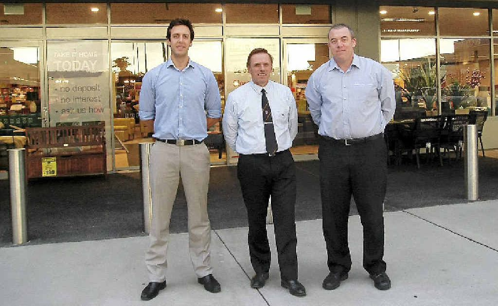 TEAM: Franchisees Sam Thompson, Neil Hollis and Christopher Stewart at the Harvey Norman store in Ballina.
