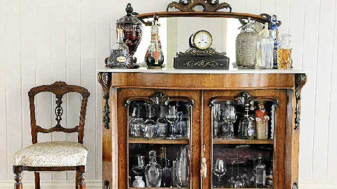 A Victorian sideboard bought from auction and a French clock also bought at an auction.
