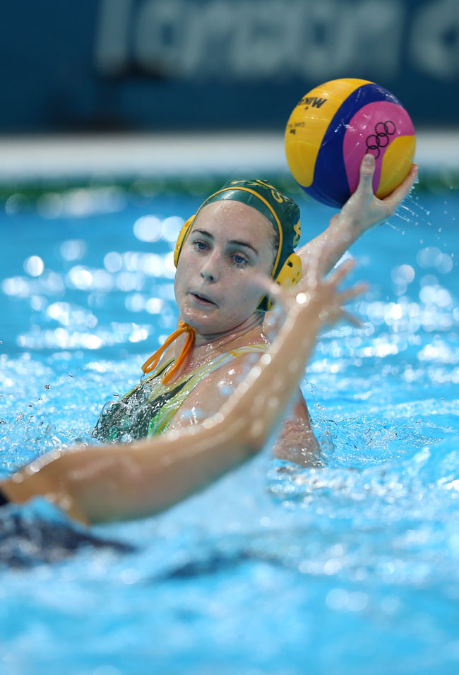 Glencora Ralph #9 of Australia passes the ball in the Women's Preliminary Round Water Polo match between Great Britain and Australia on Day 5 of the London 2012 Olympics at Water Polo Arena on August 1, 2012 in London, England.