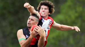 Hervey Bay Bombers full-forward Clint Ennis takes a strong grab in front of Brothers Bulldogs defender Jack Sickerdick.