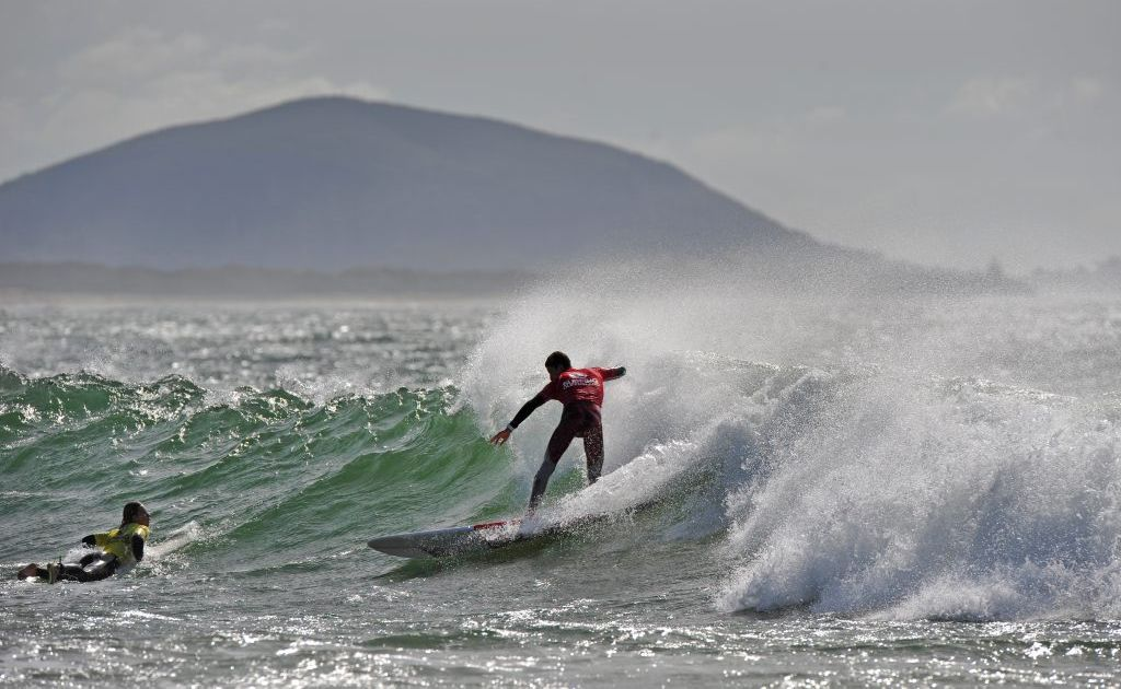 Buderim's Nic Jones on his way to retaining his crown at the Queensland Longboard Titles.