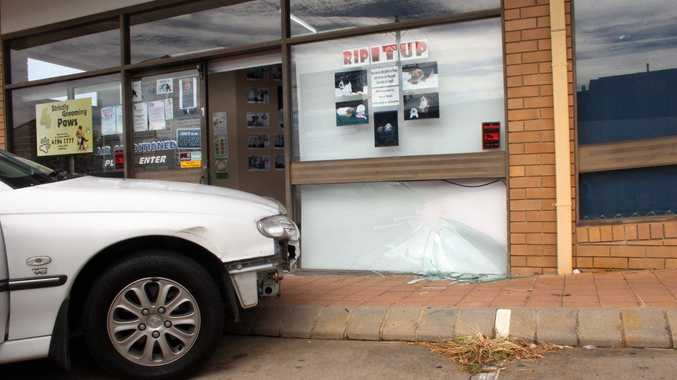 A Holden Commodore hit the front window of a Hervey Bay shop.