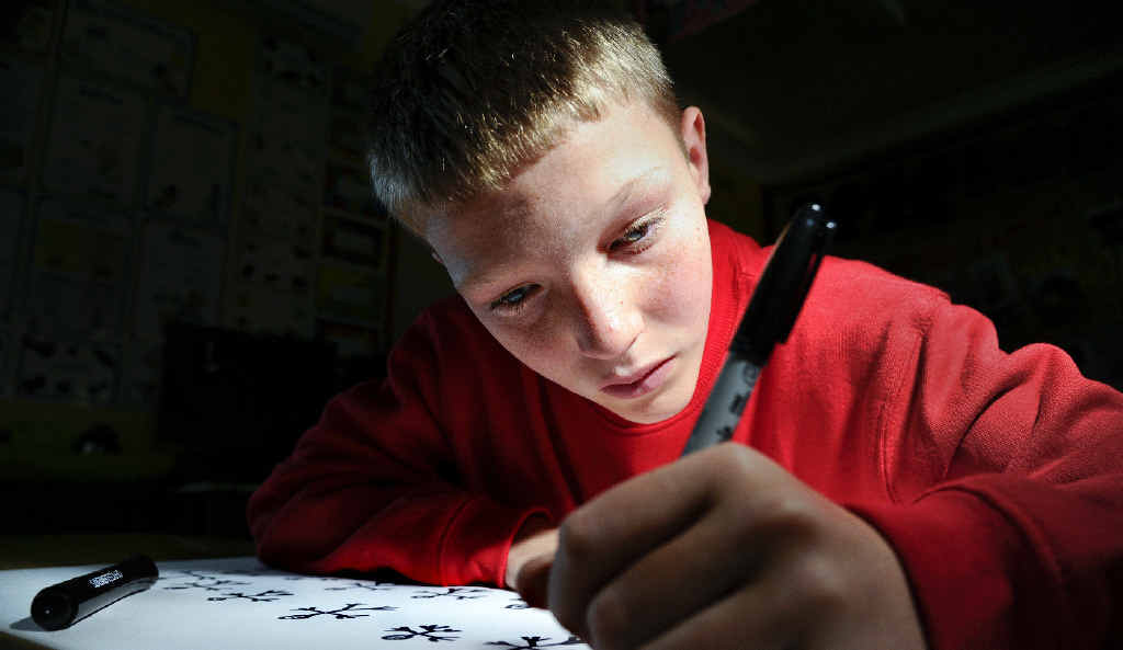 Blake Parrott, 11, is vision impaired but loves to draw. The Lawrence Public School student recently returned from Sydney where his artwork was hung in the Australian Museum as part of the Schools Reconciliation Challenge art display.