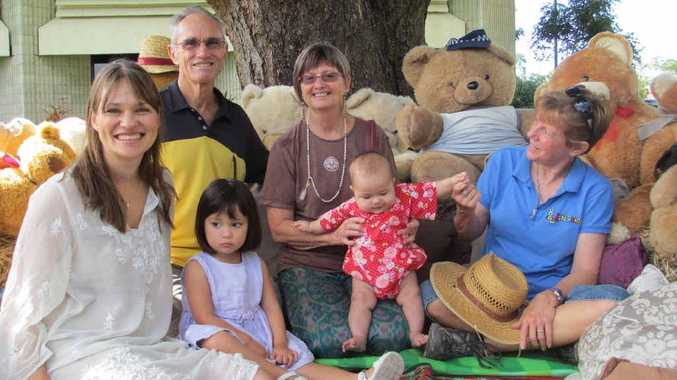 Baby Bliss Oyama was the centre of attention among family members (from left) Gai Oyama, Joy Oyama, Morrie Pearson and Cheryl Pearson and Sue Bowen, of Let's Read, at Mackay's Baby Welcoming Ceremony at the civic precinct yesterday.