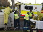 Emergency services attend a two vehicle crash where a van rolled on the corner of Curzon and Ipswich Sts, Tuesday, June 04, 2013. Photo Kevin Farmer / The Chronicle