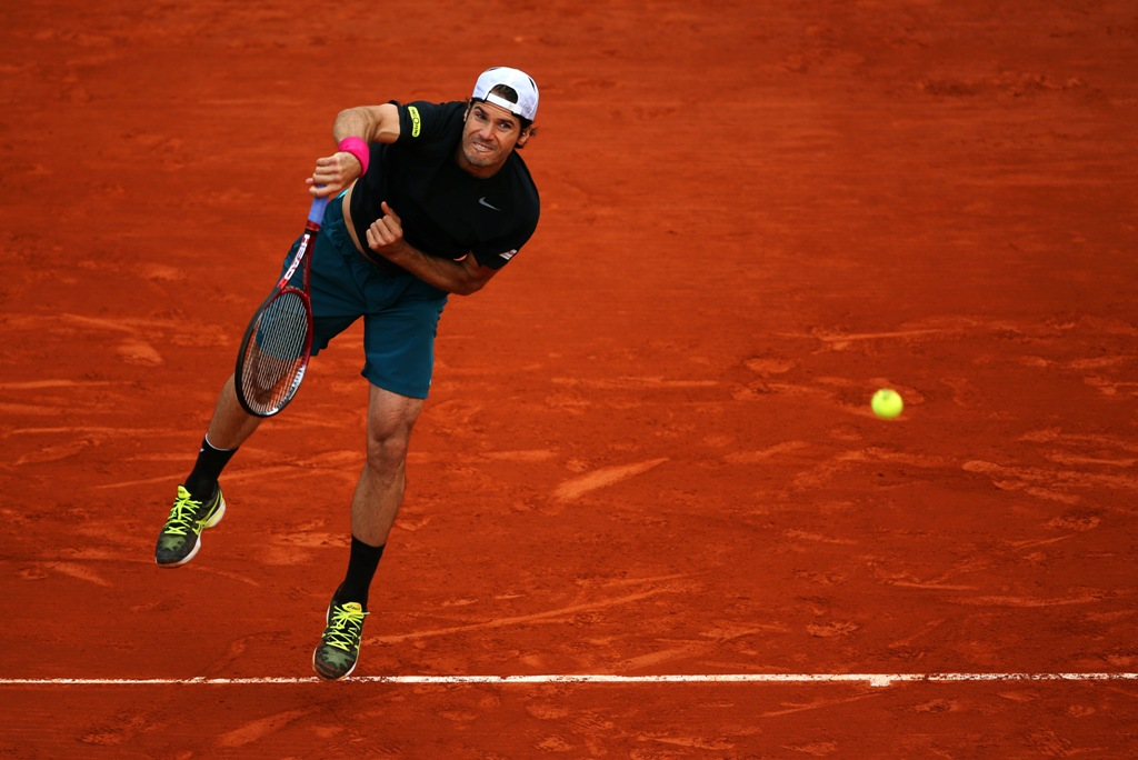 Tommy Haas of Germany serves during his Men's Singles match against Mikhail Youzhny of Russian Federation on day nine of the French Open at Roland Garros on June 3, 2013 in Paris, France.