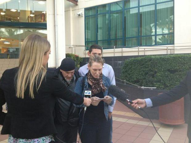 Luke McAuliffe's family members speak to media outside the Rockhampton courthouse.