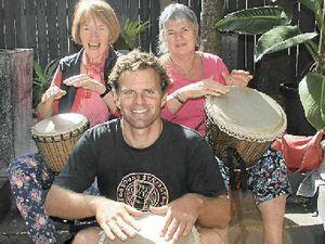 Aspiring buskers in seniors drumming circle at Byron Bay