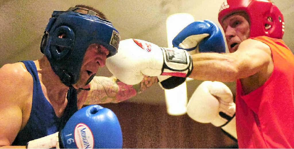 FIGHT NIGHT: Paul Howorth, of Murwillumbah, and Woodburn's Gavin Begbie go head-to-head during their fight at Woodburn-Evans Head RSL Club's big night of boxing, organised by the Evans Head-Woodburn Boxing Club.