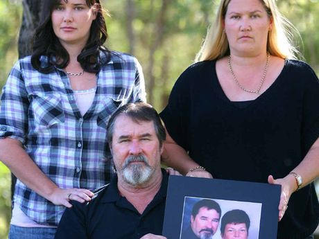 Ken Williams (centre) and his daughters (from left) Tammy Williams and Jodi McFarlane stand strong with a photo of their beloved wife and mother Karen.