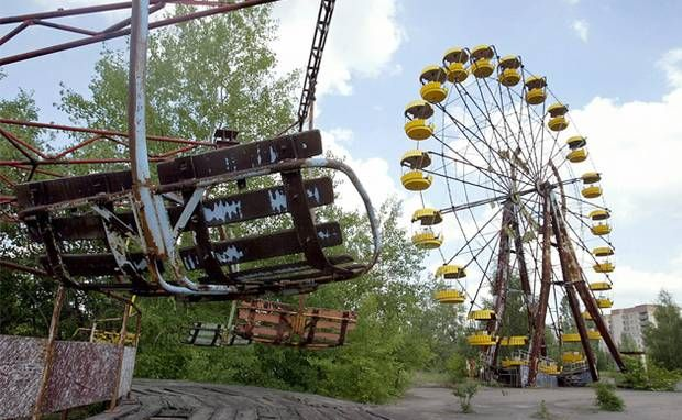 A ferris wheel and carousel abandoned in the amusement park in the ghost town of Prypyat, adjacent to the Chernobyl nuclear plant.