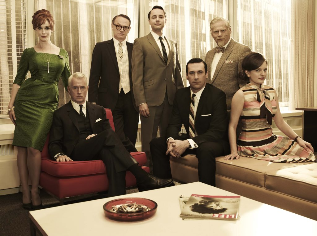 The cast of the TV series Mad Men, from left, Christina Hendricks, John Slattery, Jared Harris, Vincent Kartheiser, Jon Hamm (seated), Robert Morse and Elisabeth Moss.