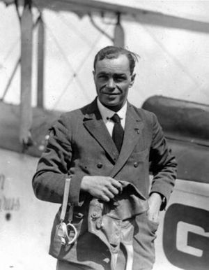 Bert Hinkler during his prime time, carrying flying cap and goggles.