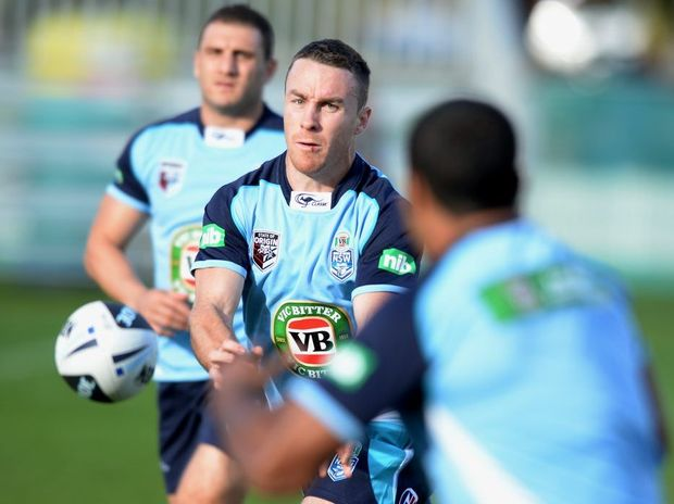 NSW Blues player James Maloney takes part in a light training run at Coogee Oval, in Sydney.