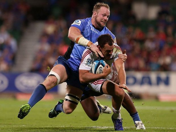 Richard Brown of the Force tackles Isreal Dagg of the Crusaders during the round 9 Super Rugby match between the Western Force and the Crusaders at nib Stadium on April 13, 2013 in Perth, Australia.
