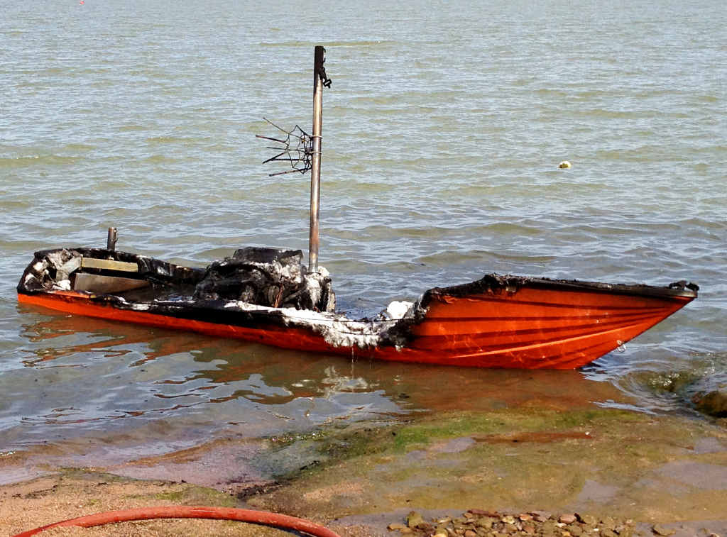 WRITTEN OFF: The wreck of the ski boat that burnt to the waterline on Sunday at Fairbairn Dam.
