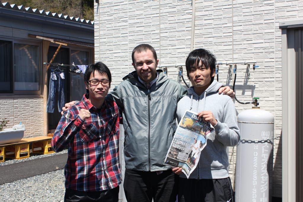 Taito Miura, David Stuart and Shota Izumi in the temporary village near the junior high school in Minami Sanriku. Photo: Shinichi Yonemori