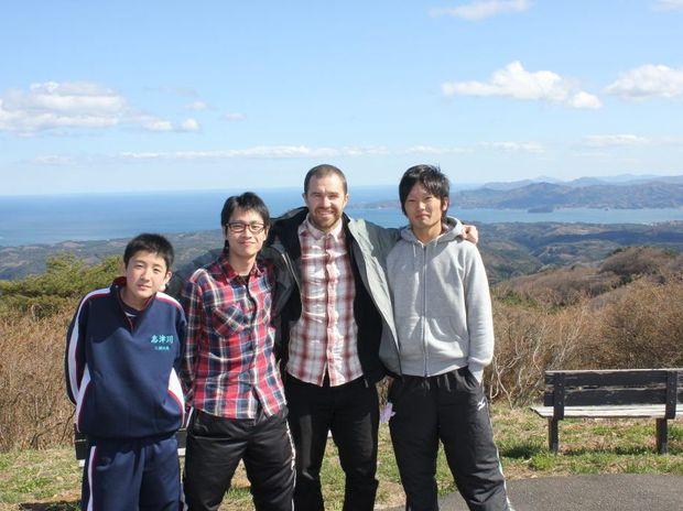 Soma Miura, Taito Miura, David Stuart and Shota Izumi in Miyagi Prefecture, Japan with Minami Sanriku in the background.