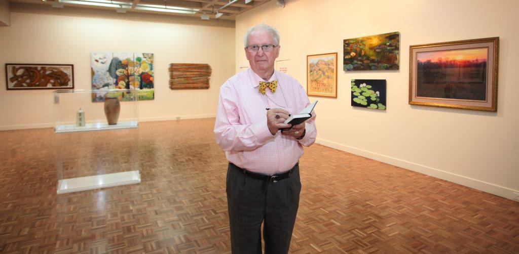Bishop John Bayton at Rockhampton Art Gallery to judge the 2013 Bayton Award. Photo Allan Reinikka / The Morning Bulletin