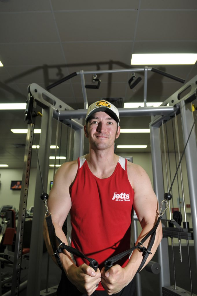 Matthew Leitch ploughs through pain as he works out at the gym.