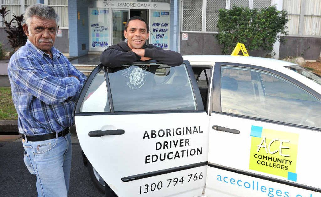 ON A ROLL: Tabulam elder Uncle Bucky, driving instructor for ACE in Lismore with his grandson, who he is teaching to drive, Basil Robinson of Casino.