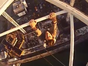 Vertigo-inducing video of climber dangling from crane