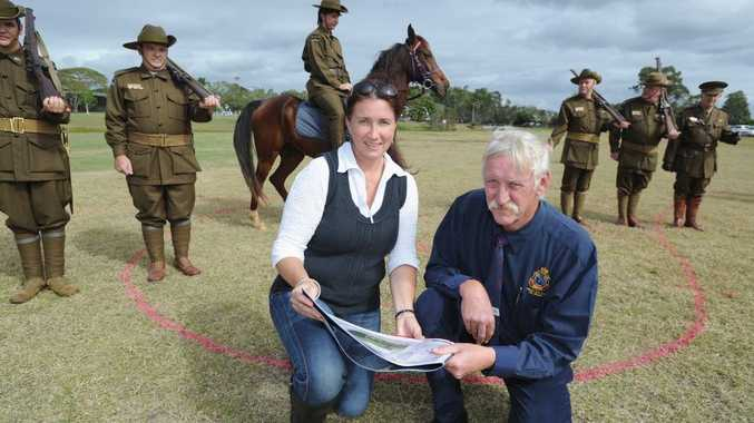 New anzac park next to Hervey Bay Community Centre - Lisa Mercer (senior landscape architect) from Cardno and John Kelsey (president Hervey Bay RSL sub-branch) with the 9th battalion WW1 re-enactment group. Photo: Alistair Brightman / Fraser Coast Chronicle