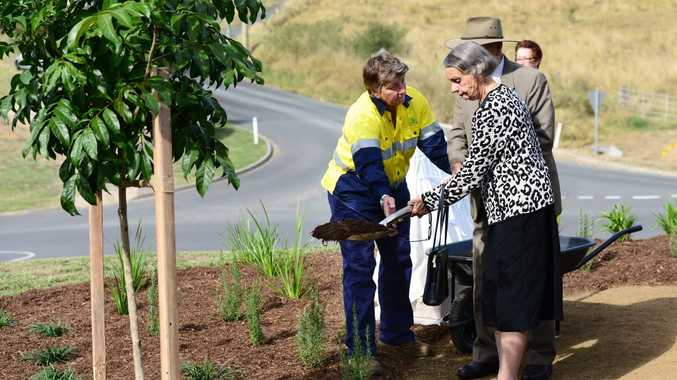 Lisa Taylor (left) helps Doris Fredman and Rub Logan plant a tree in memory of their relative RAAF Pilot Officer-observer Lex Logan who died fighting the Japanese in WWII.