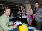 Craig Lowndes meets some of his biggest fans, including Jasmine, Amanda and Louise Tully, at Mount Pleasant Shopping Centre yesterday.