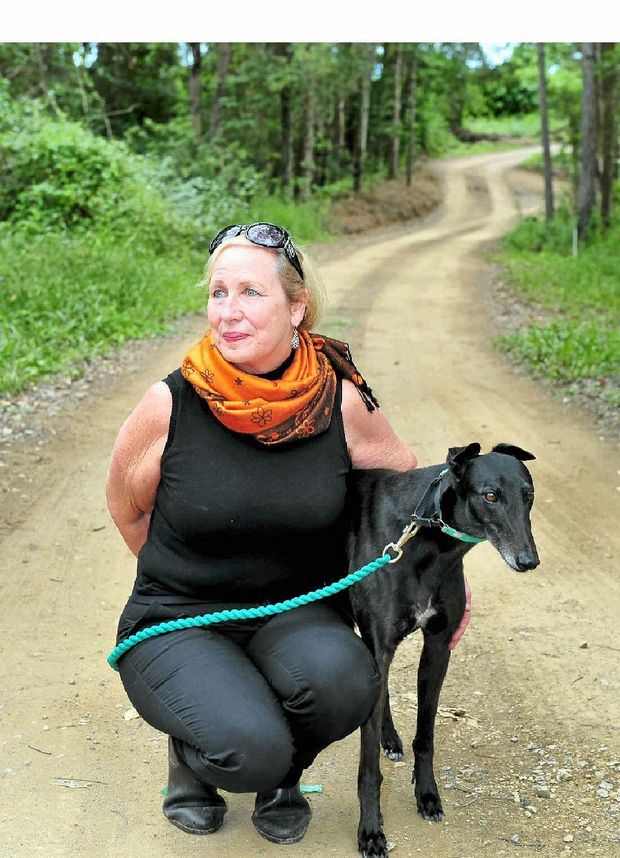 Greens candidate for Wide Bay Joy Ringrose and her dog Dee at the site of a proposed chicken farm that she is opposing.