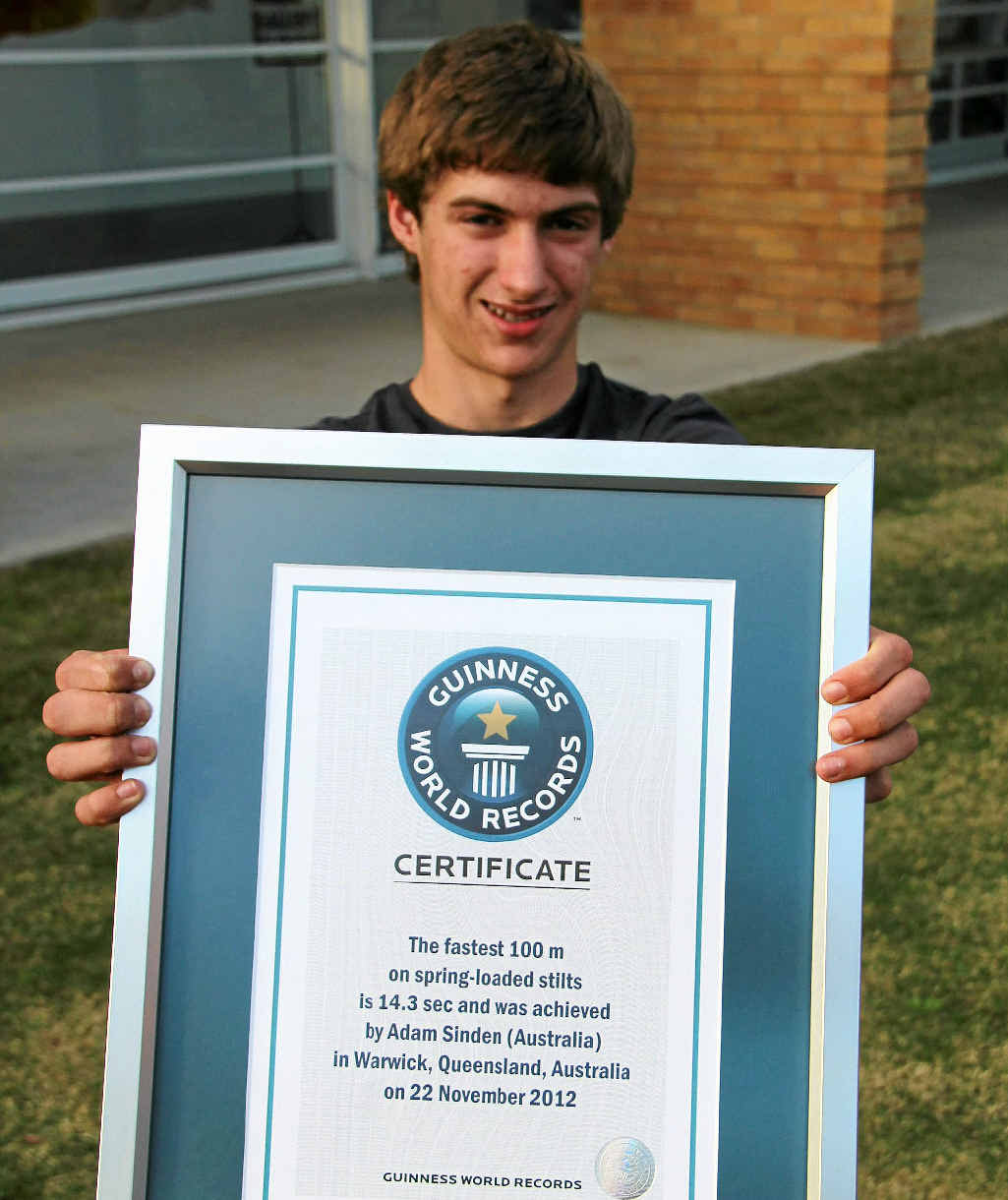 Warwick teenager Adam Sinden has earned himself a spot in the Guinness World Records book for his 100m sprint on jumping stilts.