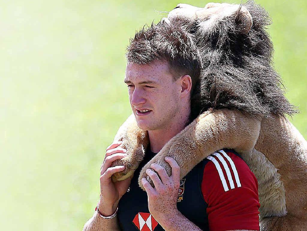 TOY BOY: Stuart Hogg carries the Lions' mascot, Bil, named after the British and Irish Lions.