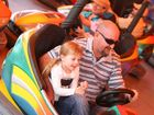 Paul Cooper with his daughter Marley on the dodgems at the Rockhampton Show. Photo: Chris Ison / The Morning Bulletin