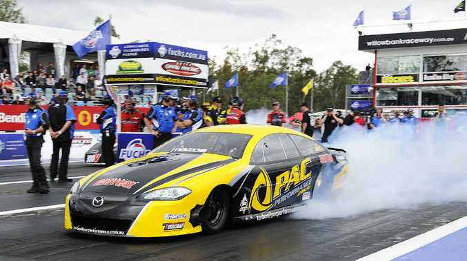 SMOKE 'EM UP: Action from the Winternationals at Willowbank Raceway kept crowds entertained.