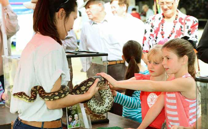 Megan Adams of Geckoes Wildlife Presentations with Emma Little, 9, (right) and Shayla Duffy, 6.
