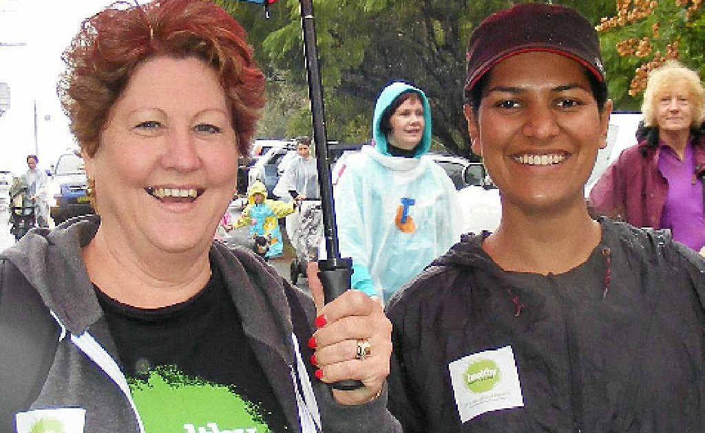 BRAVING RAIN: Vickie Williams, of Nimbin, and Yogita Gupta of Lismore, at Saturday's annual Lifeline Walk the Walk fundraiser.