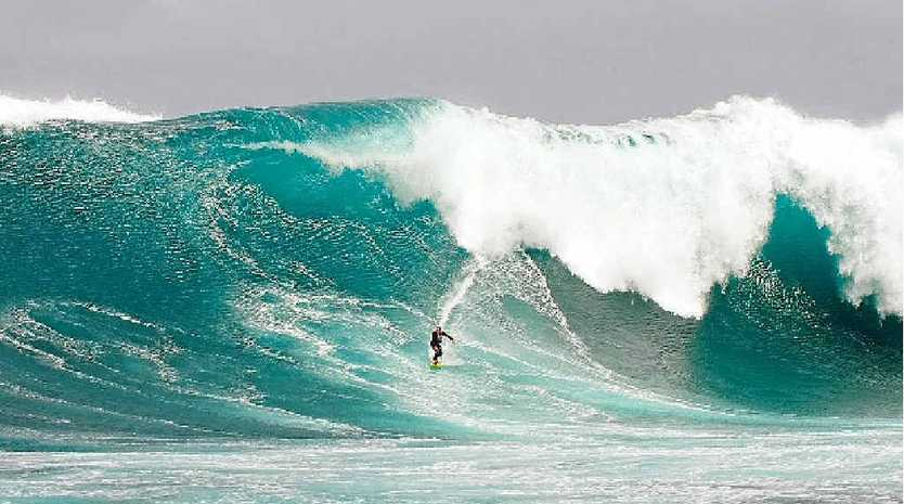 THE MAN'S MAD: Sunshine Coast surfer Mark Visser rides an 11m wave at Cow Bombie, 2.5km offshore from Grace Town, Western Australia.