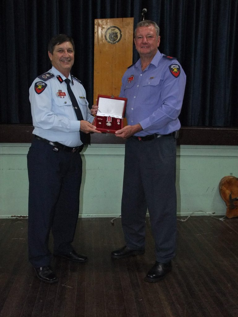 OUTSTANDING SERVICE: Queensland Fire and Rescue Service Commissioner Lee Johnson presents Captain Roger Stubbs with the Commissioner's Distinguished Service Medal Photo George Smith / Central & North Burnett Times