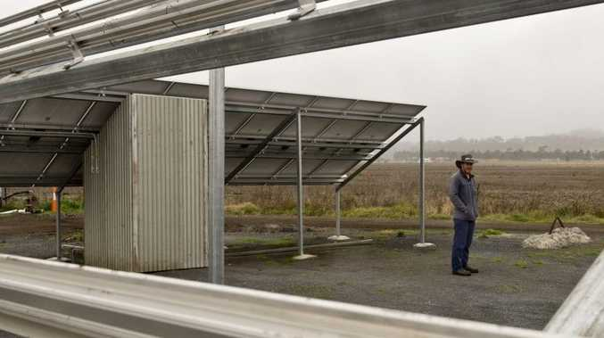 Lettuce farmer Paul Finlayson inspects the empty rack from which 20 solar panels were stolen.