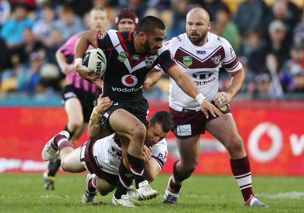 Thomas Leuluai of the Warriors is tackled during the round 13 NRL match between the New Zealand Warriors and the Manly Sea Eagles at Mt Smart Stadium on June 9, 2013 in Auckland, New Zealand.