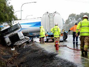 Petrol tanker jack-knifes on wet highway