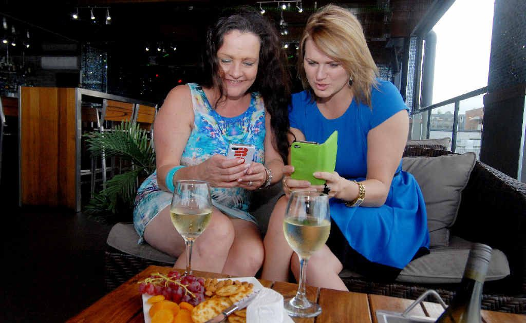 Tracy Coster and Chantelle Fielding at Mojos trying out new app.