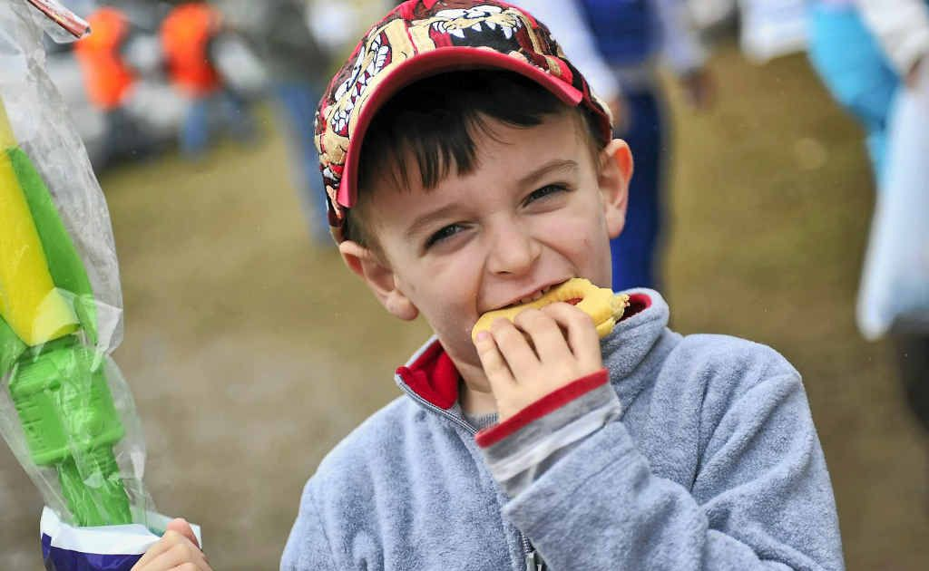SHOW DELIGHTS: Macca Holgate-English, 4, enjoys a cookie at The 2012 Mt Larcom Show.