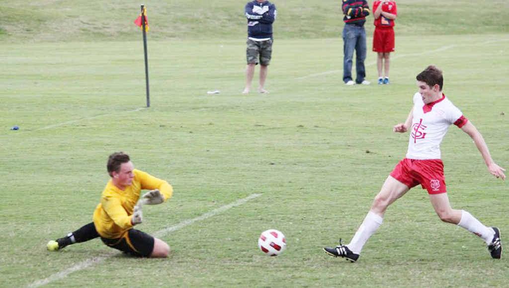 DETERMINED ATTACK: Skilful Ipswich Grammar School goal scorer Tom Webster challenges the BBC goalkeeper during last weekend's GPS match.