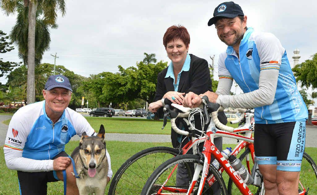 Kim Evans, his dog Devil and support rider Darryl Pursey are welcomed by Mayor Deirdre Comerford yesterday during a stopover in Mackay as part of their fundraising ride around Australia.