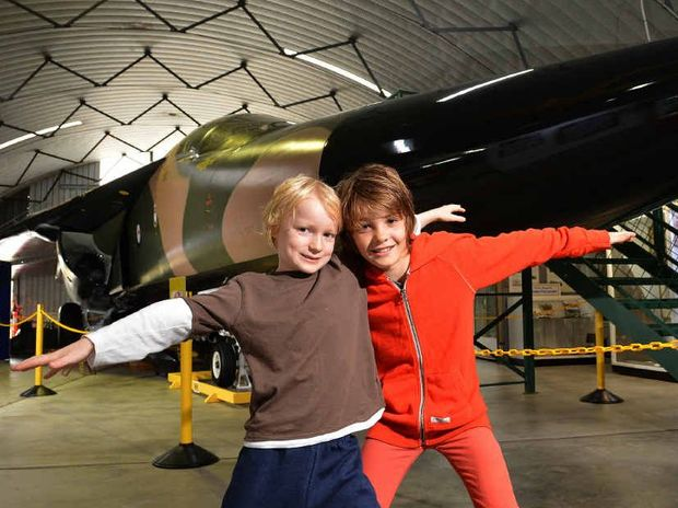 "Charlie Ciavarella, 10, of Peregian, and his cousin Tom Moles, 7, of Boreen Point, ""take off"" as they have a good look at the F-111."