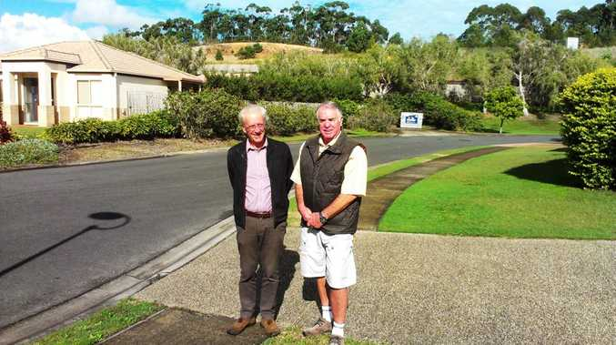 Tweed mayor Barry Longland with Oasis Community Association president John Wray. Behind them is the proposed site of the storage facility.