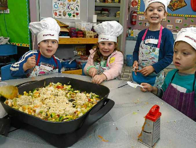 TASTE TEST: MiniChefs (from left) Rhyan Rogers, Esther Young, Byron Leard, and Sam Ensby, all 4, from Wollongbar Community Preschool get set to try the fried rice they learnt to cook at Blue Hills College in Goonellabah.